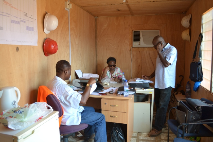 My parents & my uncle in their site office.